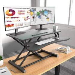 Sit-Stand 升降電腦枱 按壓兩側手柄,即可隨意調節高度,站立坐低都可以用。